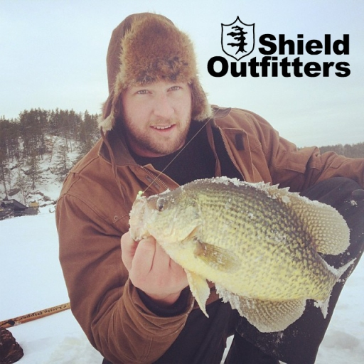 "The author and owner/guide of Shield Outfitters with a nice 16"" crappie."