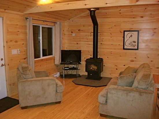 The living room of the Deluxe One Bedroom cabin.